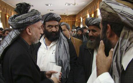 President Hamid Karzai, left, meets local leaders in Lashkar Gah, in Helmand province (AP)