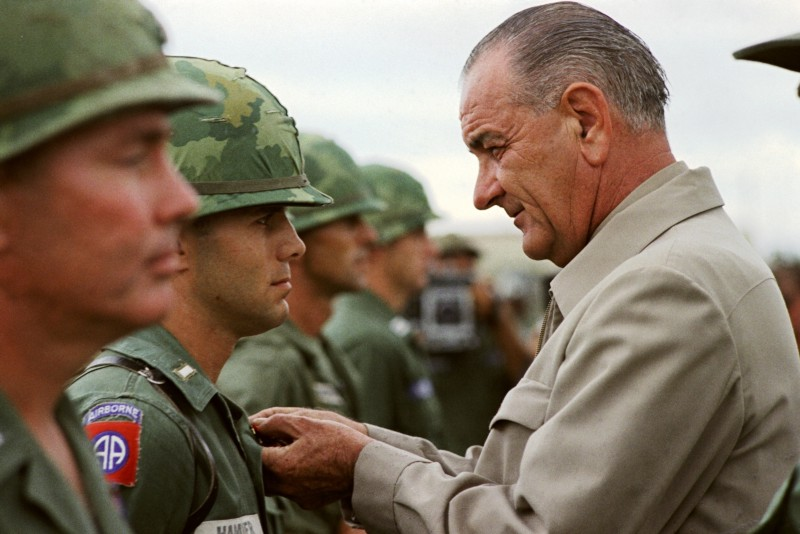 Johnson awards a medal to a US soldier during a visit to Vietnam in 1966.