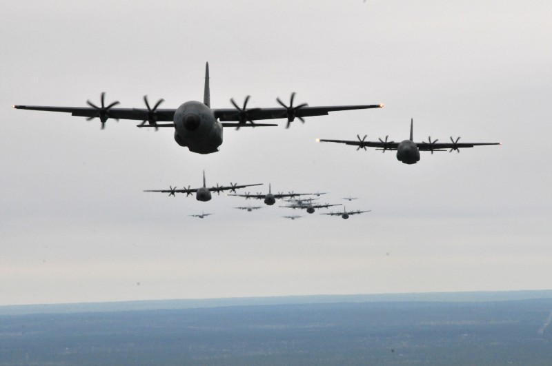 C-130J Hercules and WC-130J Hercules fly in formation during an Operation Surge Capacity exercise over the Mississippi Gulf Coast region April, 5, 2014.(Photo: Sr Amn Nicholas Monteleone/USAF)
