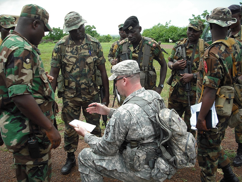 Sgt. 1st Class Grady Hyatt, U.S. Army Africa, leads an after-action review with soldiers of the Ghana Army, following training. The Army aligned the 2nd Brigade Combat Team, 1st Infantry Division, with U.S. Africa Command. The unit will serve for a year as the go-to force for AFRICOM. (U.S. Army Photo)