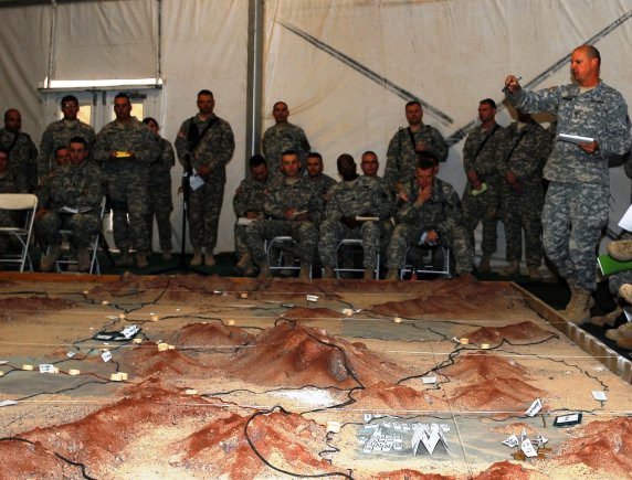 Members of the leadership and staff of the New York Army National Guard's 27th Infantry Brigade Combat Team review the operations plan of the brigade during the unit combined arms rehearsal at Fort Irwin, Calif., Oct. 5,2011.