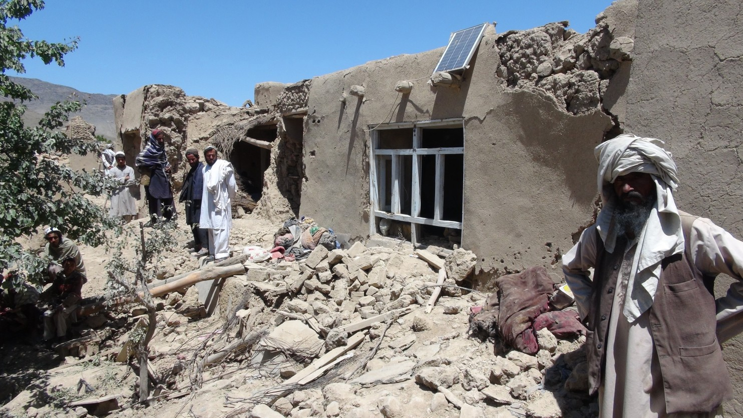 """Afghan villagers gather near a house destroyed in a NATO raid in Logar province, south of Kabul, Afghanistan on June, 6, 2012. The airstrike was called in by U.S. troops after they came under fire while pursuing a Taliban fighter in a village in the Baraki Barak district. (Ihsanullah Majroh/AP) Like many insurgencies in the past, the Taliban utilize the well-worn tactic of shielding themselves amongst innocent civilians. In modern times, this has led to unfortunate loss of civilian life because of the moral hazard that occurs when friendly land forces are compelled in self defense to respond to enemy fire with firepower of their own. It is in this fashion where land power, and its associated usage of firepower in response to """"troops in contact"""" event hardly result in discriminate application of force, or a """"precise rheostat,"""" and thus it is just as capable of creating negative impacts upon strategic effect as the usage of other forms of military power. A Humans Right Watch report titled, """" Troops in Contact ,"""" states the following: """"High civilian loss of life during airstrikes has almost always occurred during the fluid, rapid-response strikes, often carried out in support of ground troops after they came under insurgent attack. Such unplanned strikes included situations where US special forces units—normally small numbers of lightly armed personnel—came under insurgent attack; in US/NATO attacks in pursuit of insurgent forces that had retreated to populated villages; and in air attacks where US 'anticipatory self-defense' rules of engagement applied."""""""