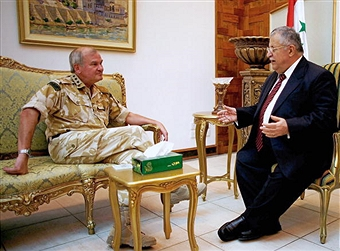 Lieutenant General Sir Robert Fry with Iraqi President Jalal Talabani in 2006. (Getty Images)