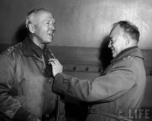 "General Eisenhower is pinning on Patton's third star on 16 March 1943. In contrast to Patton's flamboyant and slashing style as a high tactical commander, Eisenhower faced a different challenge as a theater-strategic commander—how to sustain the coalition while defeating the Germans and Italians. While frequently uncharitable in characterizing Ike's decisions, the British Chief of Imperial Staff, Field Marshal Alan Brooke praised Ike's performance in this area: ""I know of no other person who could have welded the Allied forces into such a fine fighting machine in the way he did, and kept balance among the many conflicting and disturbing elements which threatened at times to wreck the ship..."" (Getty Images)"