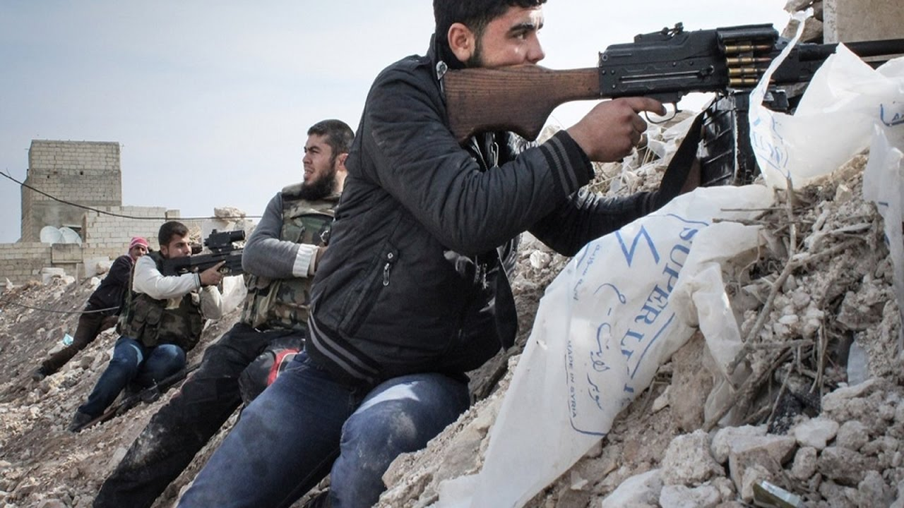 Free Syrian Army rebels take up positions along an embankment on the outskirts of the northwestern city of Maraat al-Numan, Syria. Rebels and Syrian forces fought for months over the vital Aleppo-Damascus highway between Aleppo and Hama where Maraat al-Numan is located. (Photo:  AP/Mustafa Karali )