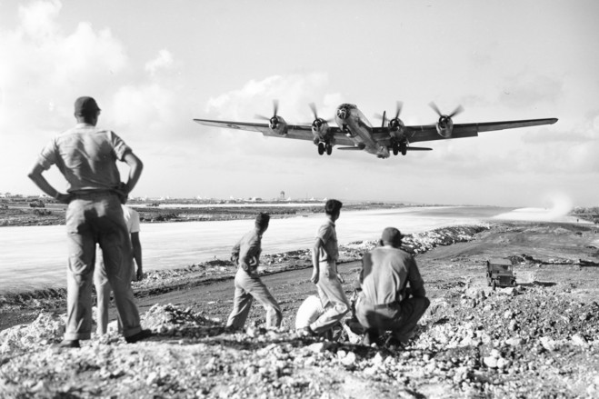 U.S. soldiers at the Saipan air base watched as a B-29 Superfortress took off for an air raid on the Japanese mainland in December 1944.(AP Photo)