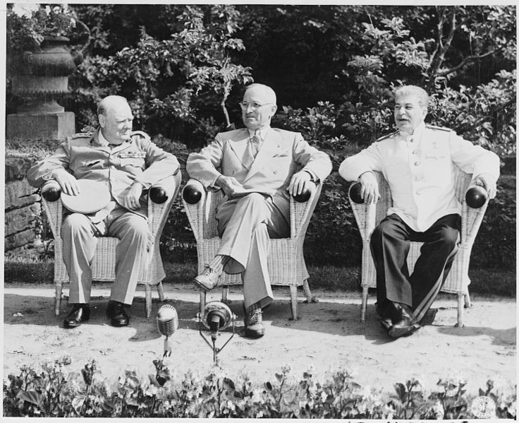 British Prime Minister Winston Churchill, President Harry S. Truman, and Soviet leader Josef Stalin in the garden of Cecilienhof Palace before meeting for the Potsdam Conference in Potsdam, Germany. (Harry S. Truman Library/Wikimedia)