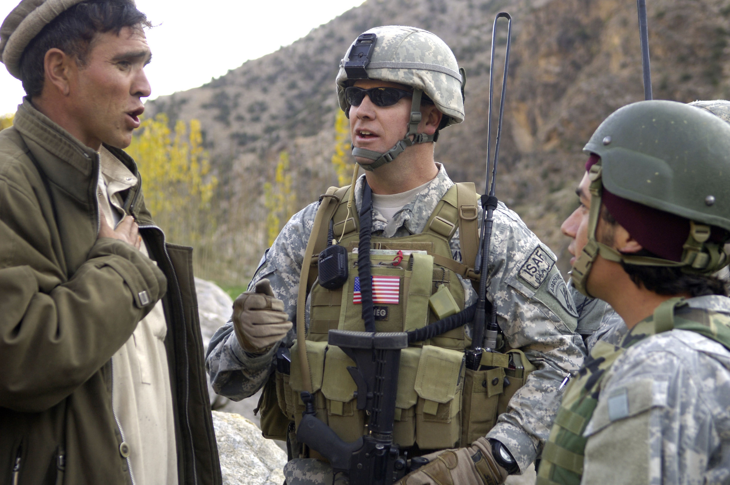 A Provisional Reconstruction Team discusses a road project in Nuristan (Casey Ware/U.S. Army Photo)