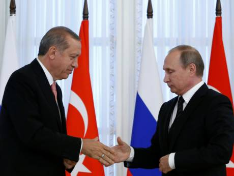 Turkish President Tayyip Erdogan shakes hands with Russian President Vladimir Putin during a news conference in 2016. (Reuters)