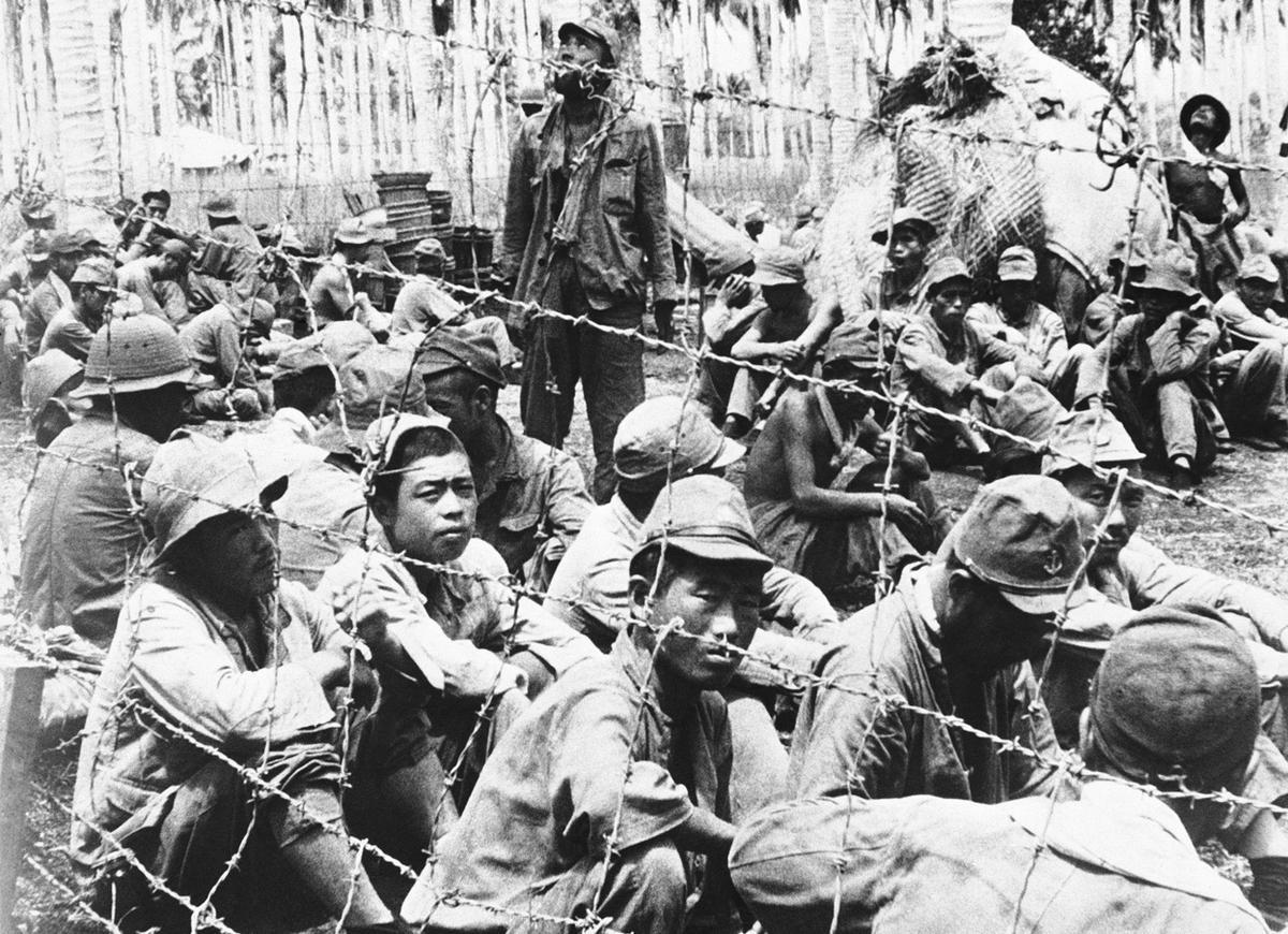 These Japanese prisoners were among those captured by U.S. forces on Guadalcanal Island in the Solomon Islands, shown November 5, 1942. (AP/Atlantic)