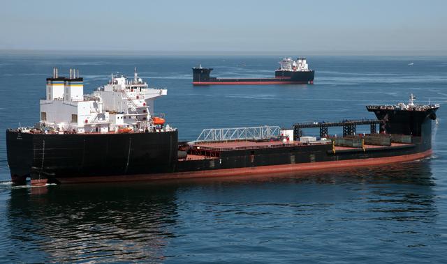 USNS Montford Point (T-ESD-1)and USNS John Glenn (T-ESD-2)pass each other near San Diego in 2014. (NASSCO photo)