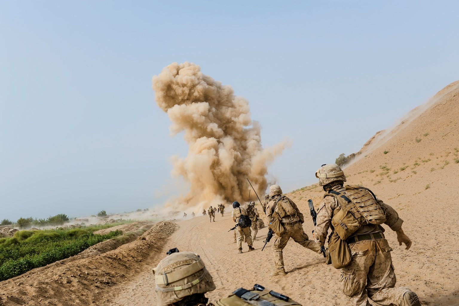 "Marines on patrol in Afghanistan in 2009 noticed a motorcyclist pass by, and moments later an IED exploded. ""It's like being kicked by a horse, a horse with a foot that could cover your entire body,"" said one survivor of an IED attack. Peter van Agtmael 