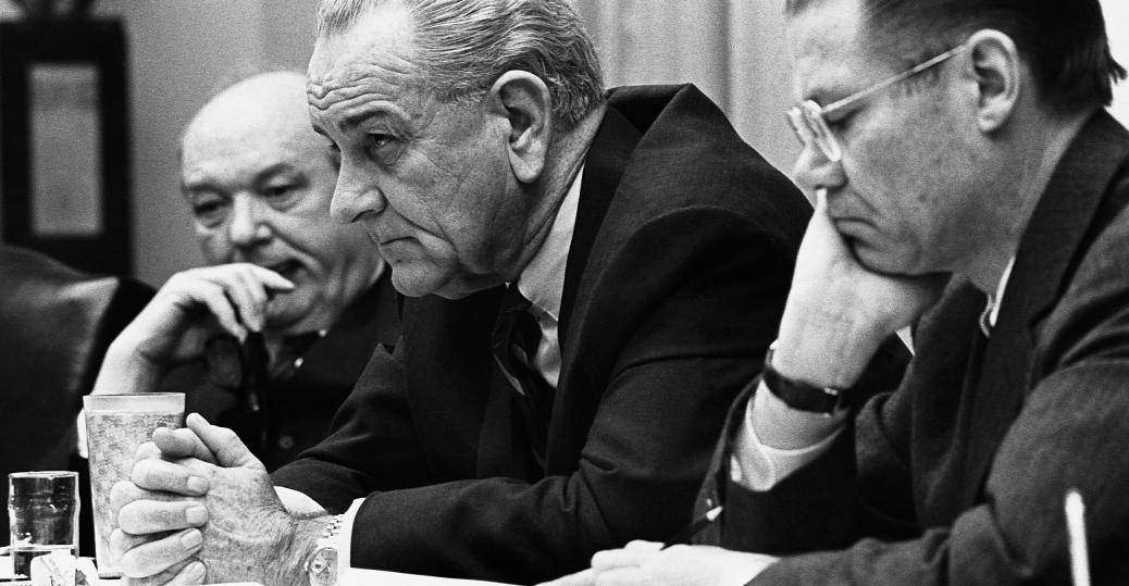 President Johnson meets with Secretary of Defense Robert McNamara and other advisors following the Tet Offensive. (History.com)