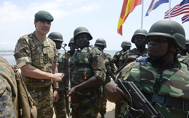 A British soldier shakes hand with his Nigerian counterpart during a joint military exercise between Nigerian armed forces, United States, Britain, Netherlands, and Spain in Lagos in 2013 (Pius Utomi Ekpei/AFP)