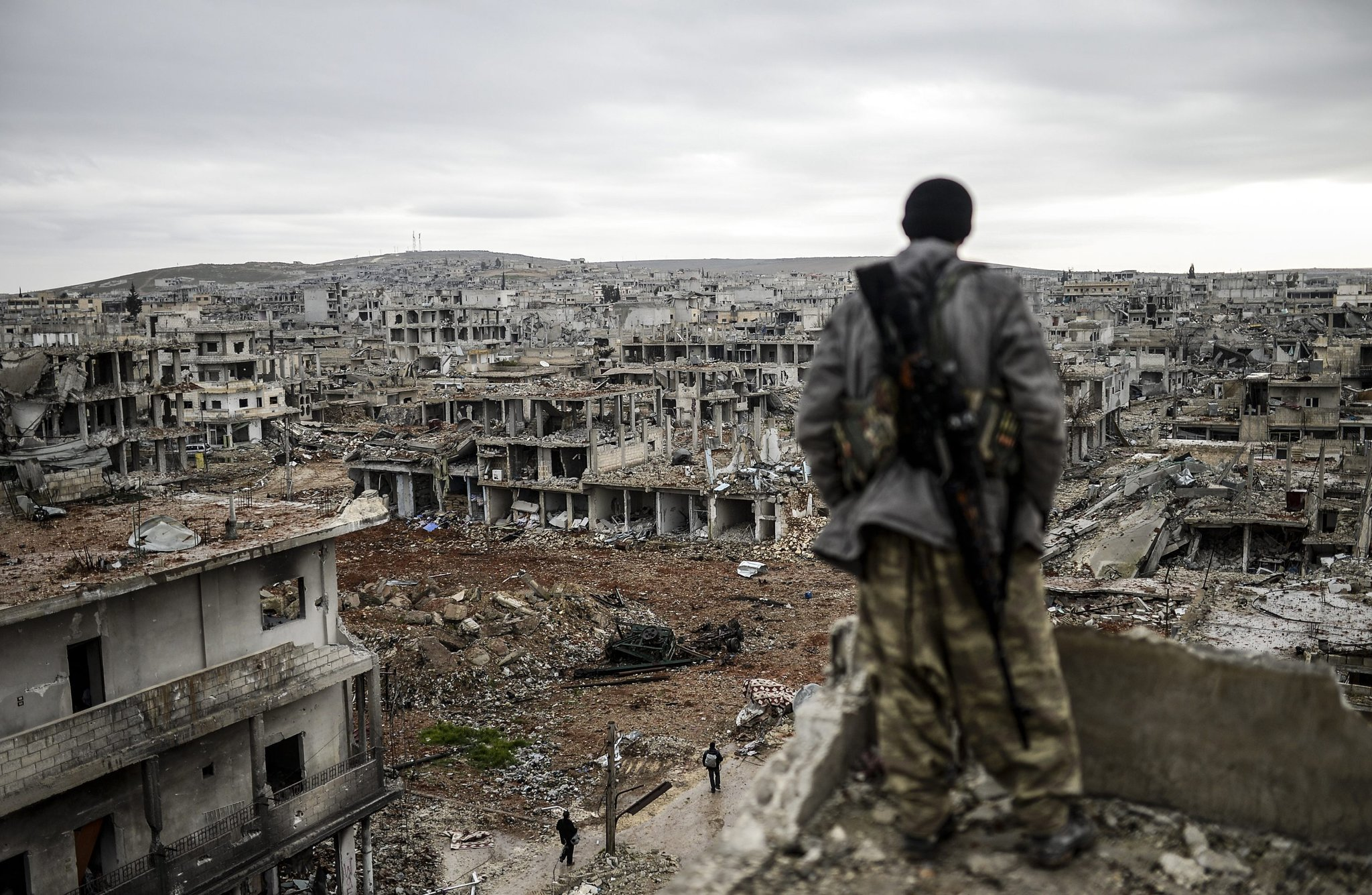 A Kurdish sniper, on top of a building in Kobani, Syria. (Bulent Kilic/AFP)