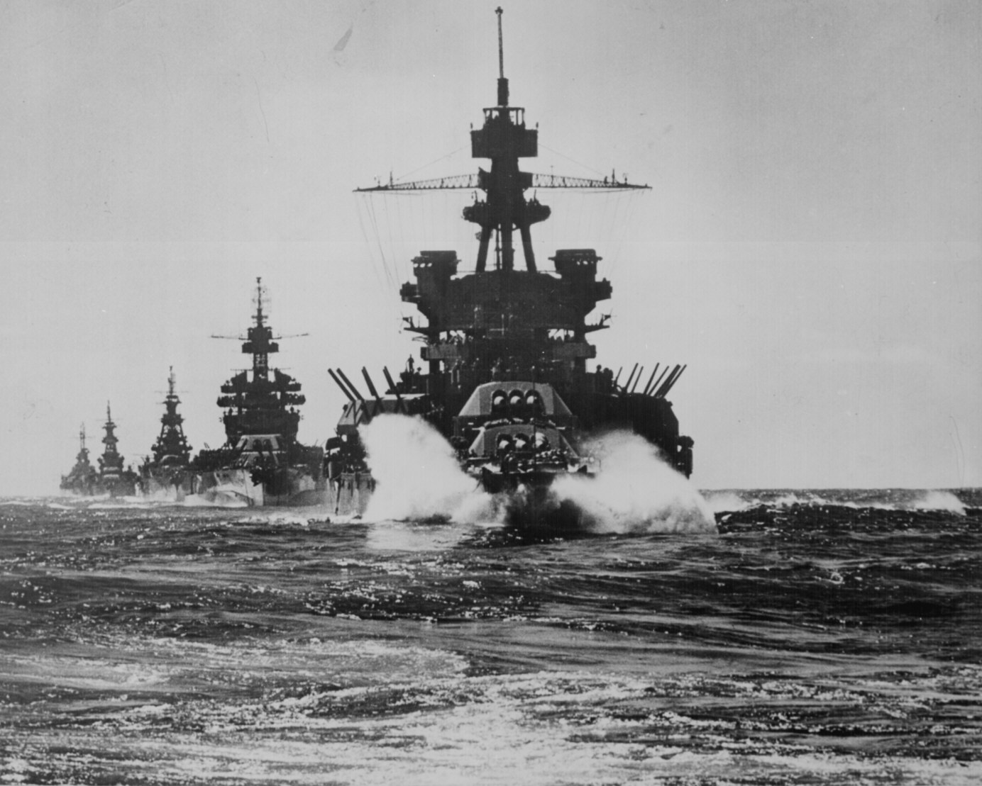 USS Pennsylvania and a Colorado-class battleship followed by three cruisers in Lingayen Gulf preceding the landing on Luzon, Philippines, January 1945. (U.S. Navy Photo/National Archives)
