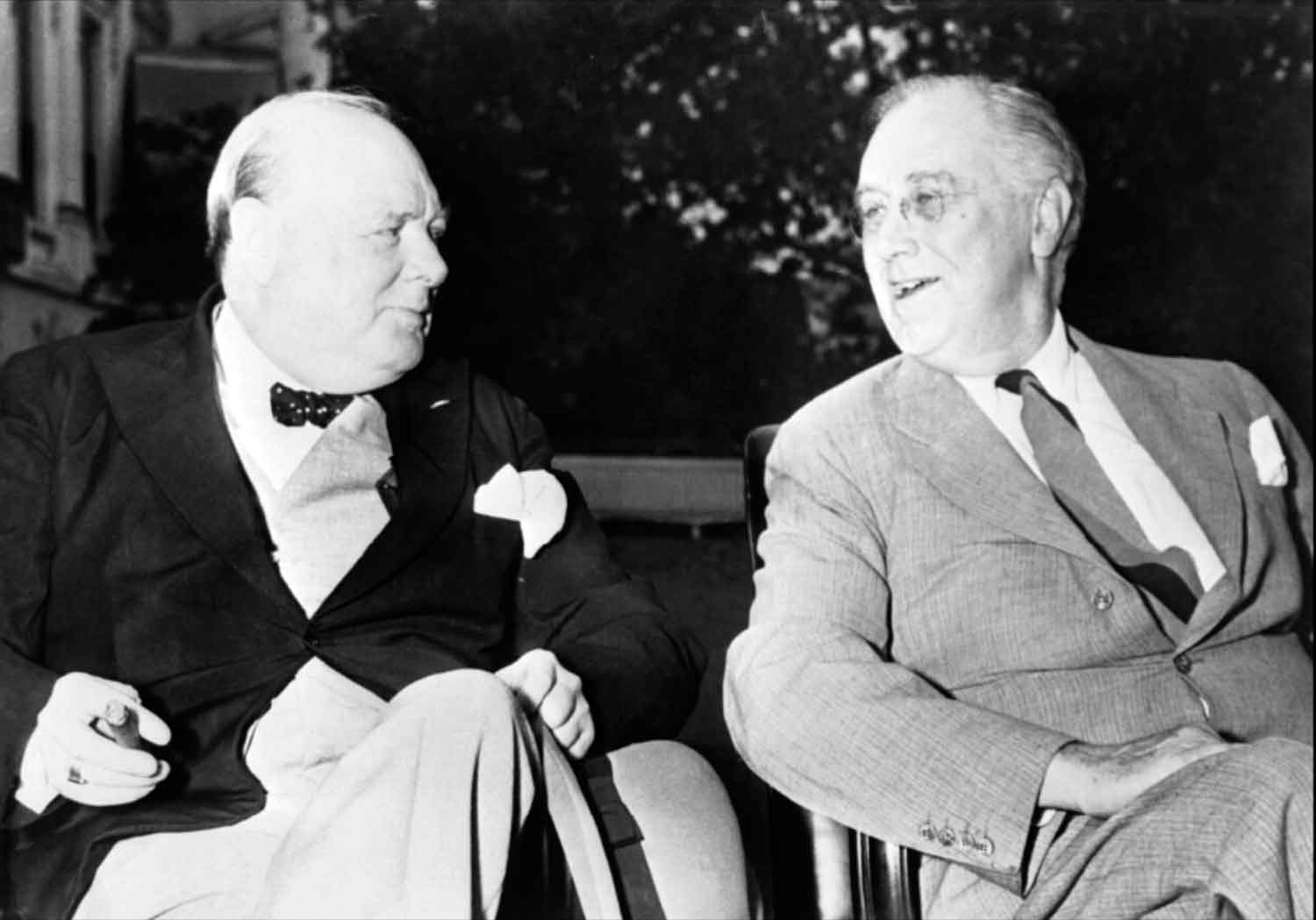 Winston Churchill and Franklin D Roosevelt relax in the grounds of the White House in Washington DC prior to a daily meeting of the joint Chiefs of Staff from the United Kingdom and United States to discuss Allied war strategy. (World War II Today)