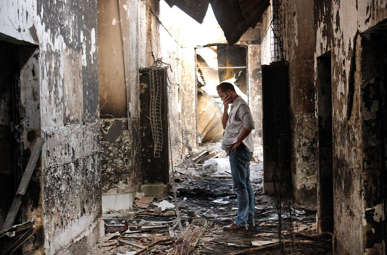 An employee of Doctors Without Borders in October 2015 inside what remained of the organization's hospital, destroyed in an airstrike that left 42 people dead. (Najim Rahim/AP)