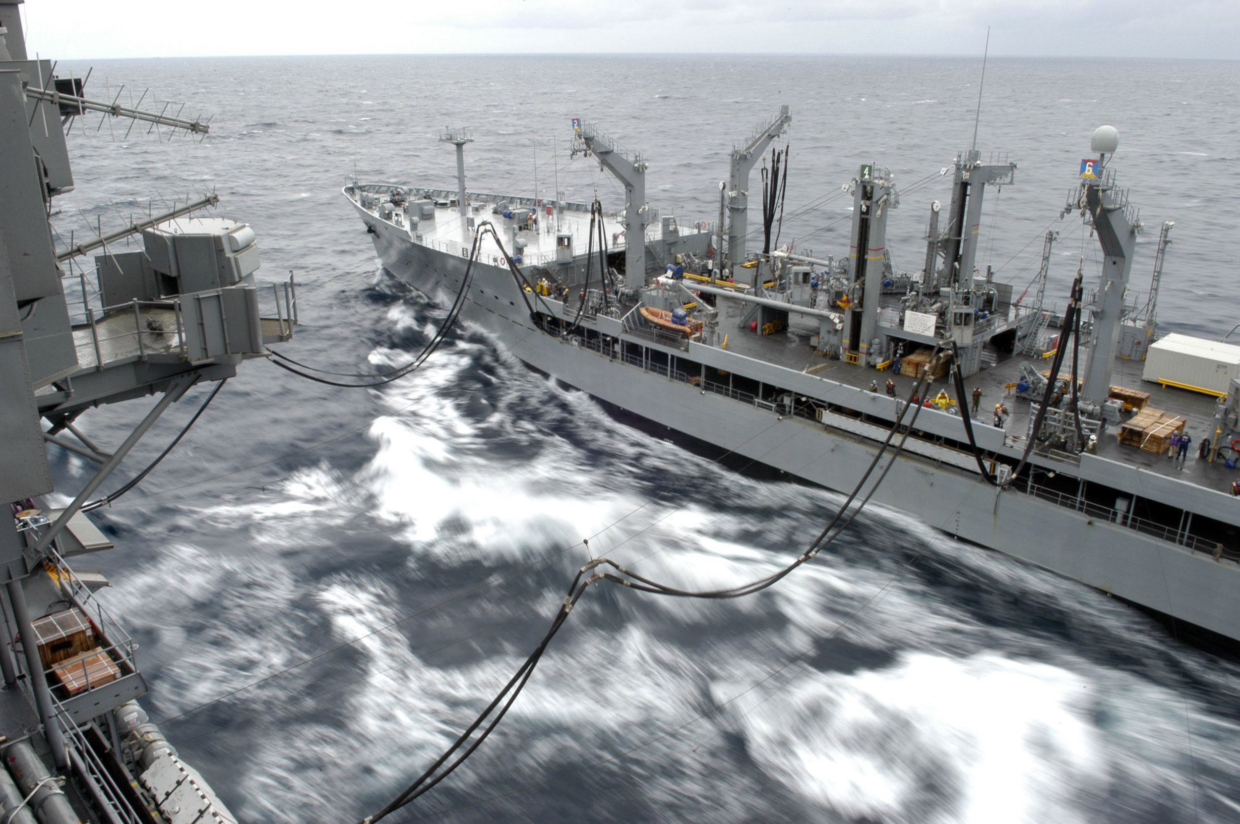 The Underway Replenishment Oilier USNS Yukon (T-AO 202) conducts a replenishment at sea (RAS) with USS Kitty Hawk (CV 63) in 2006. (Photographer's Mate Airman Jimmy C. Pan/U.S. Navy Photo)