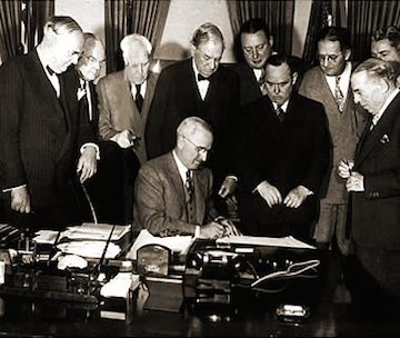 U.S. President Harry Truman signed into law the Foreign Assistance Act, commonly known as the Marshall Plan, on 3 April 1948. (George C. Marshall Foundation)