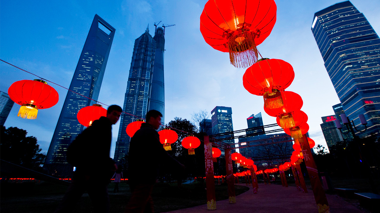 Pedestrians walk under red lanterns at Pudong Financial Area in Shanghai. (Aly Song/Reuters)