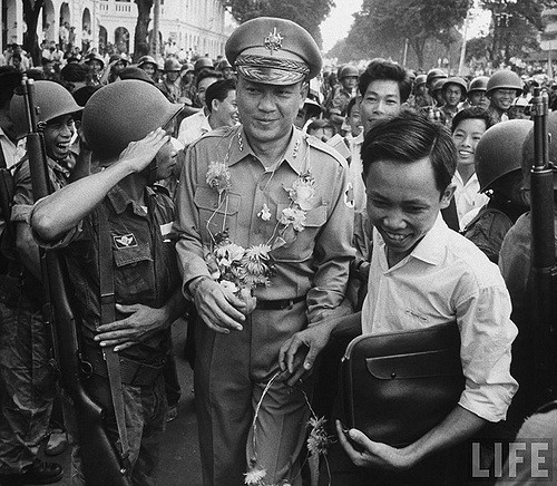 Major General Van Minh Duong, with other officers and troops celebrating the overthrow of Ngo Dinh Diem. (Getty)