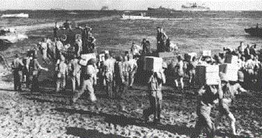 U.S. Marine Corps brings supplies ashore in the first days of the Guadacanal campaign in August 1942 ( Mackenzie Gregory )
