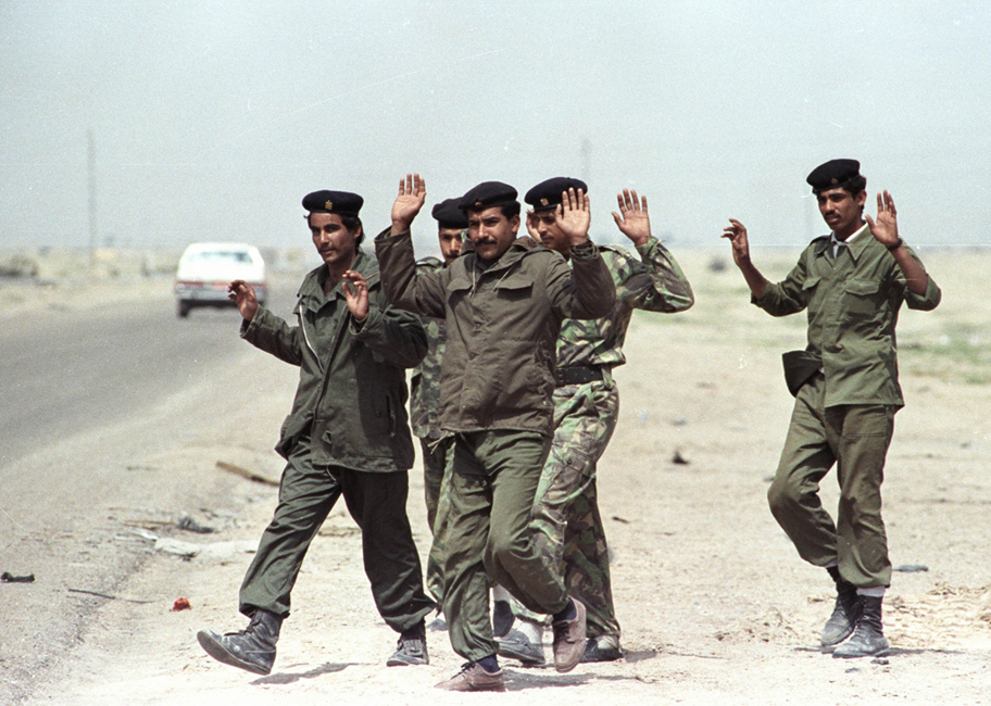 Iraqi soldier surrender to an American position during the Gulf War, March 19, 1991.