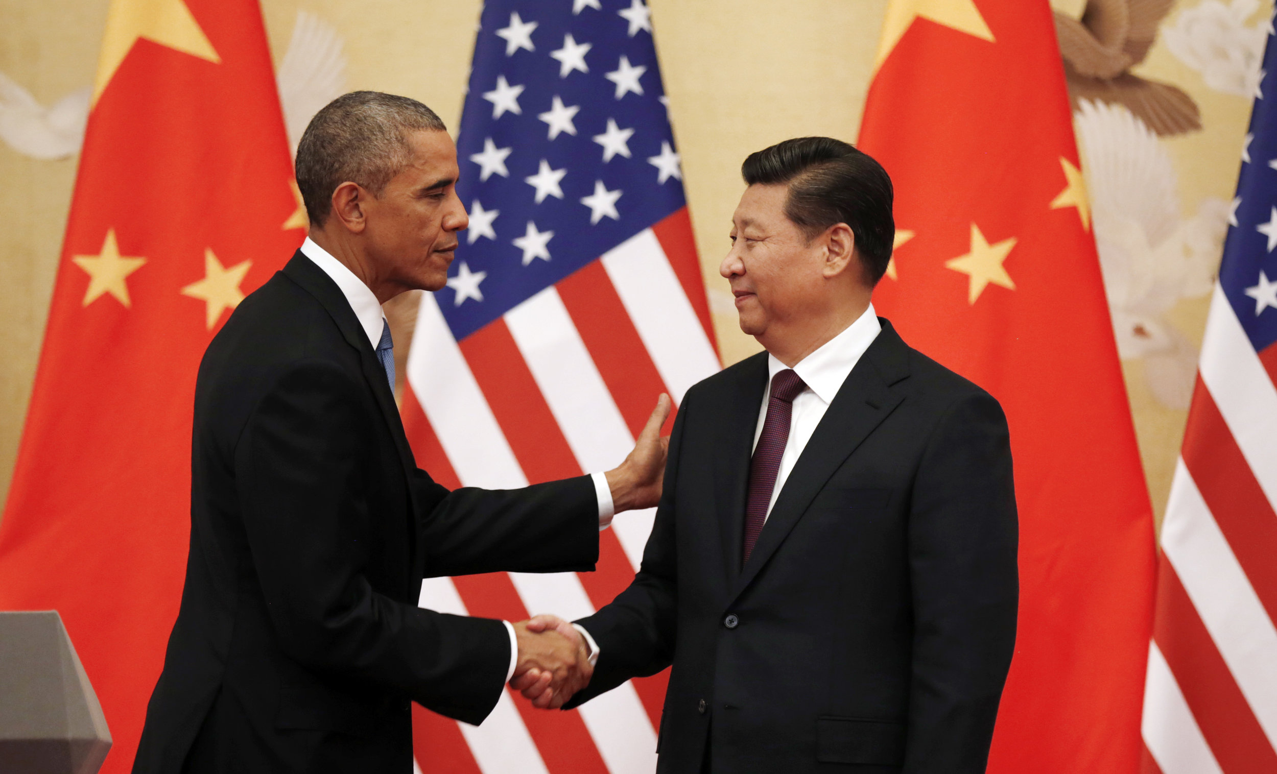 Then U.S. President Barack Obama and China's Xi Jinping in the Great Hall of the People in Beijing November 12, 2014. (Kevin Lamarque/Reuters)