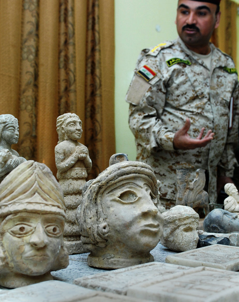 Iraqi Col. Ali Sabah, commander of the Basra Emergency Battalion, displays ancient artifacts Iraqi Security Forces discovered Dec. 16, 2008, during two raids in northern Basra. (U.S. Army Photo/Wikimedia)