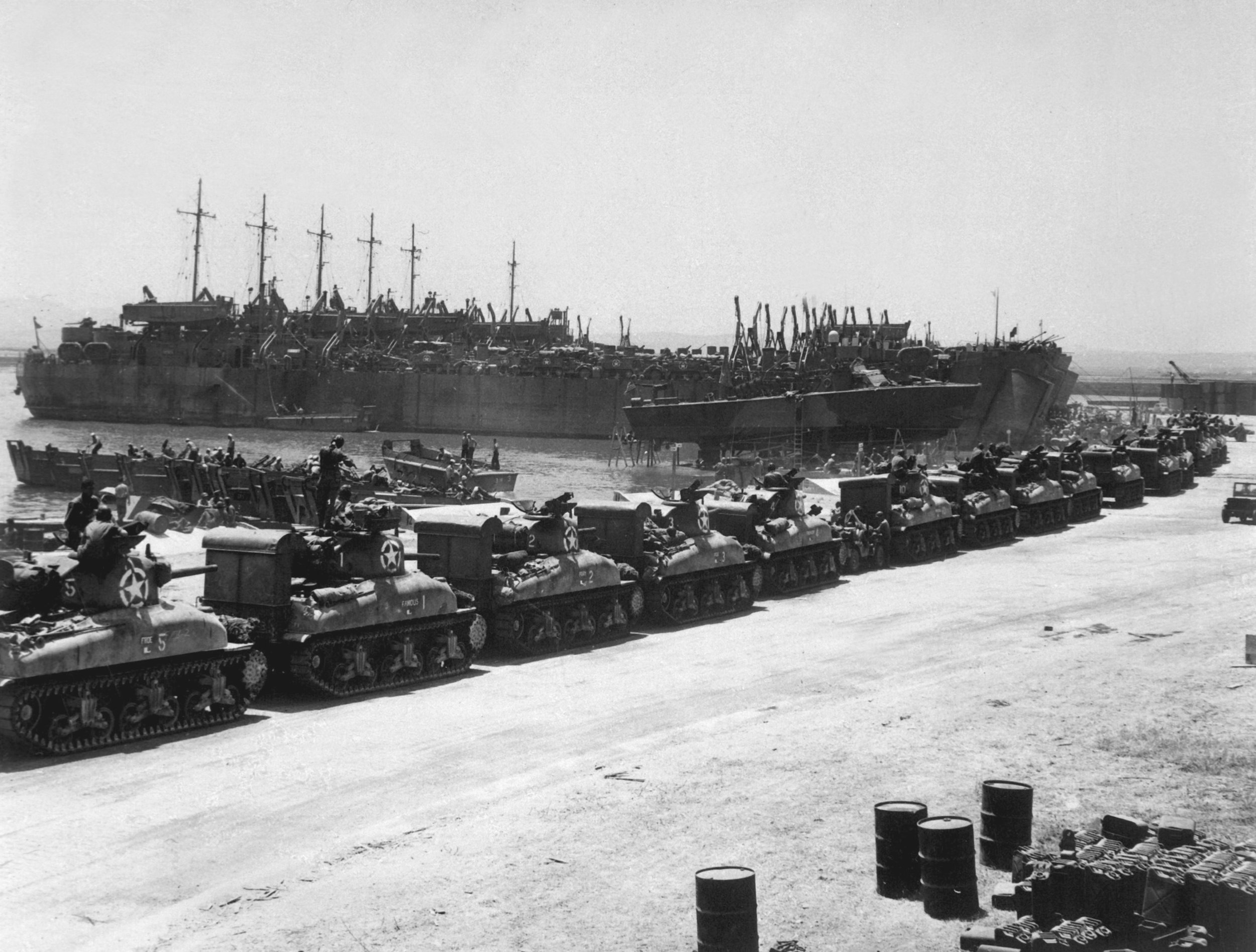 M4 Sherman tanks being loaded onto LSTs for Operation Husky, Pêcherie, Bizerte, Tunisia.