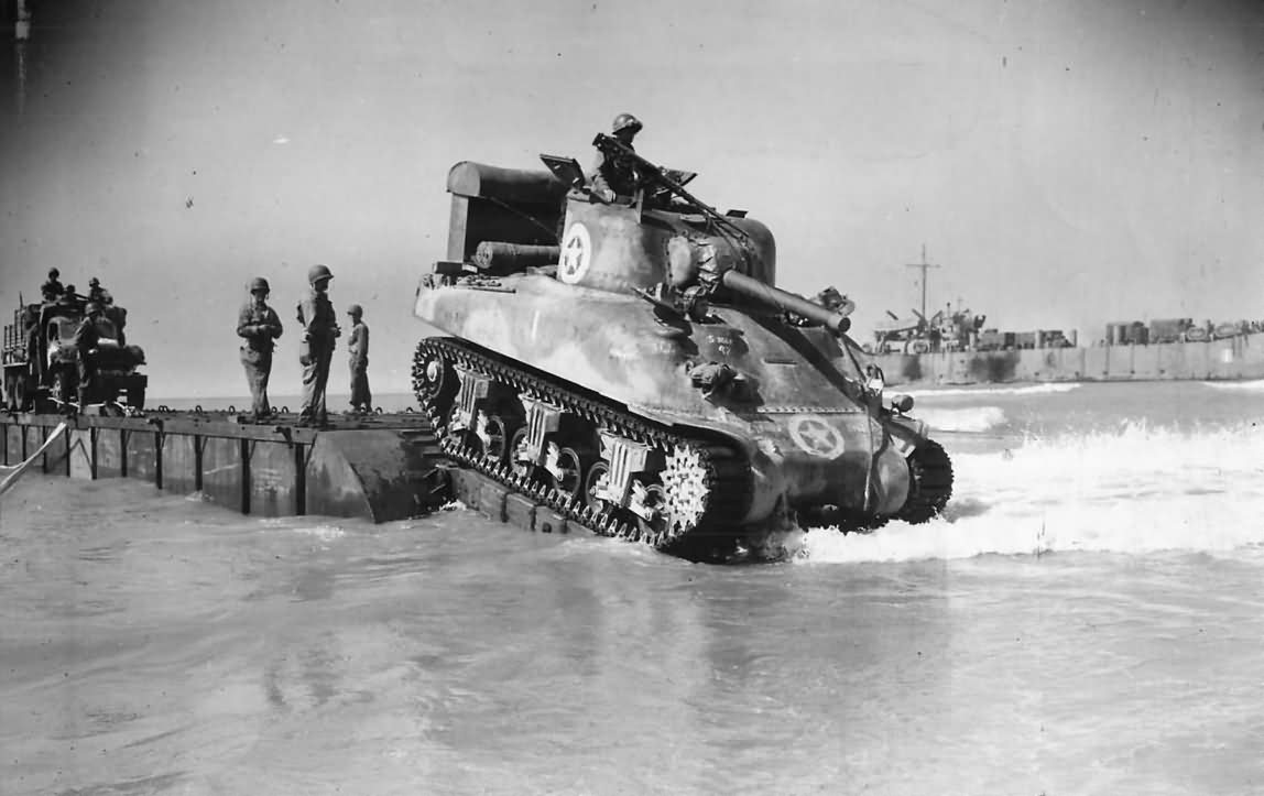 M4A1 Sherman tank of the 67th Armored Regiment, 2nd Armored Division lands during Operation Husky.