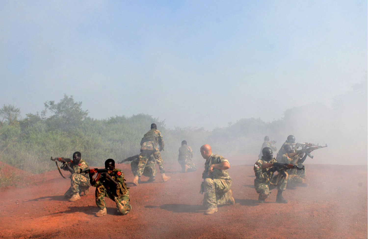 A U.S. Special Forces trainer supervises a military assault drill for a unit within the Sudan People's Liberation Army (SPLA) in Nzara. (Andreea Campean/Reuters)