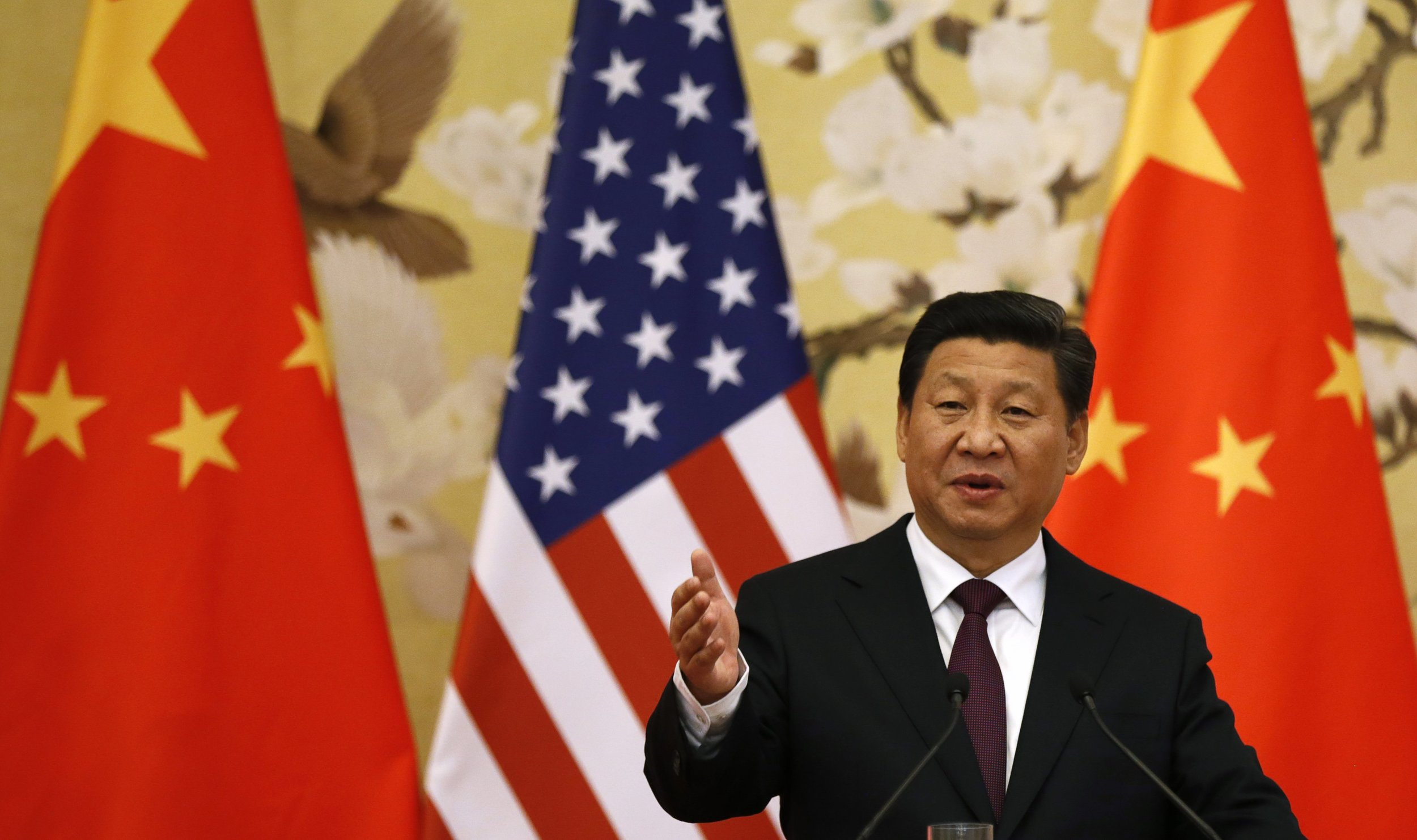 Chinese President Xi Jinping speaks during a news conference in the Great Hall of the People in Beijing November 12, 2014. (Kevin Lamarque/Reuters)