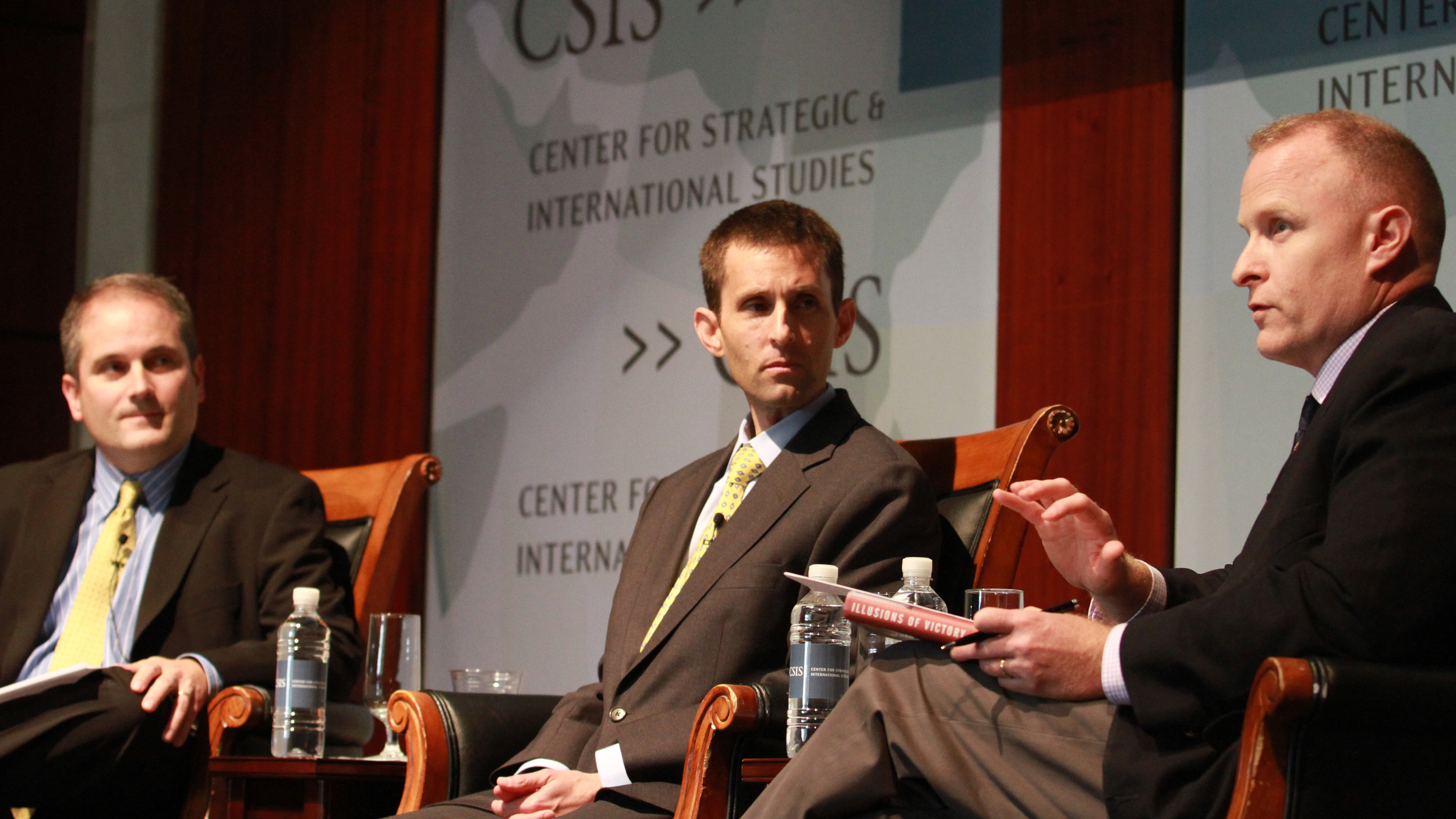 Carter Malkasian (center) talks with Dan Marston (right) at the Center for Strategic and International Studies.