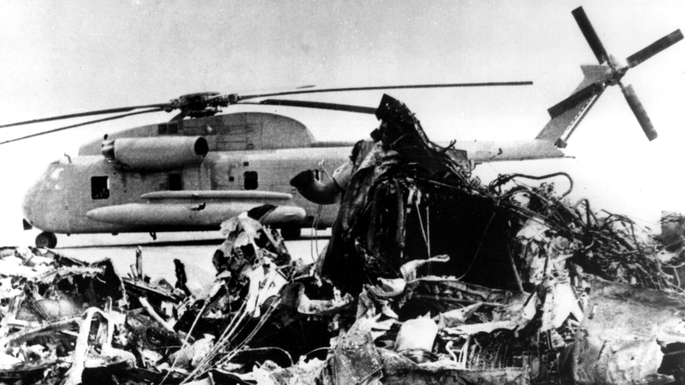 The remains of a burned-out U.S. helicopter and an abandoned chopper in the eastern desert of Iran on April 27, 1980, after the aborted American commando raid to free U.S. Embassy hostages | AP.