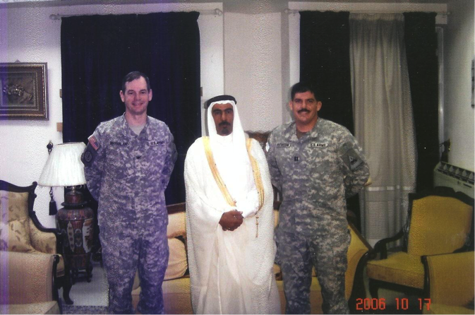 Colonel Sean MacFarland and Captain Travis Patriquin of the 1st Brigade, 1st Armored Division with Sheikh Sattar Abu Risha in Ramadi, October 2006