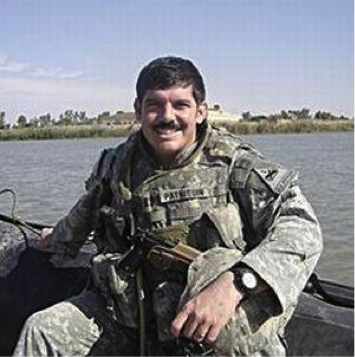 Captain Travis Patriquin on the Euphrates River near Ramadi