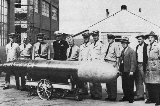 Captain Theodore Westfall, Naval Torpedo Station Commanding Officer, and Captain Carl Bushnell of the Bureau of Ordnance inspect a Mark 14 torpedo at the Naval Torpedo Station, Keyport, Washington, 1943. (Wikimedia)
