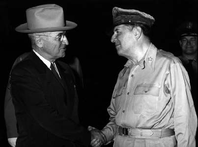 General of the Army MacArthur shakes hands with President Truman at the Wake Island Conference. (Wikimedia)