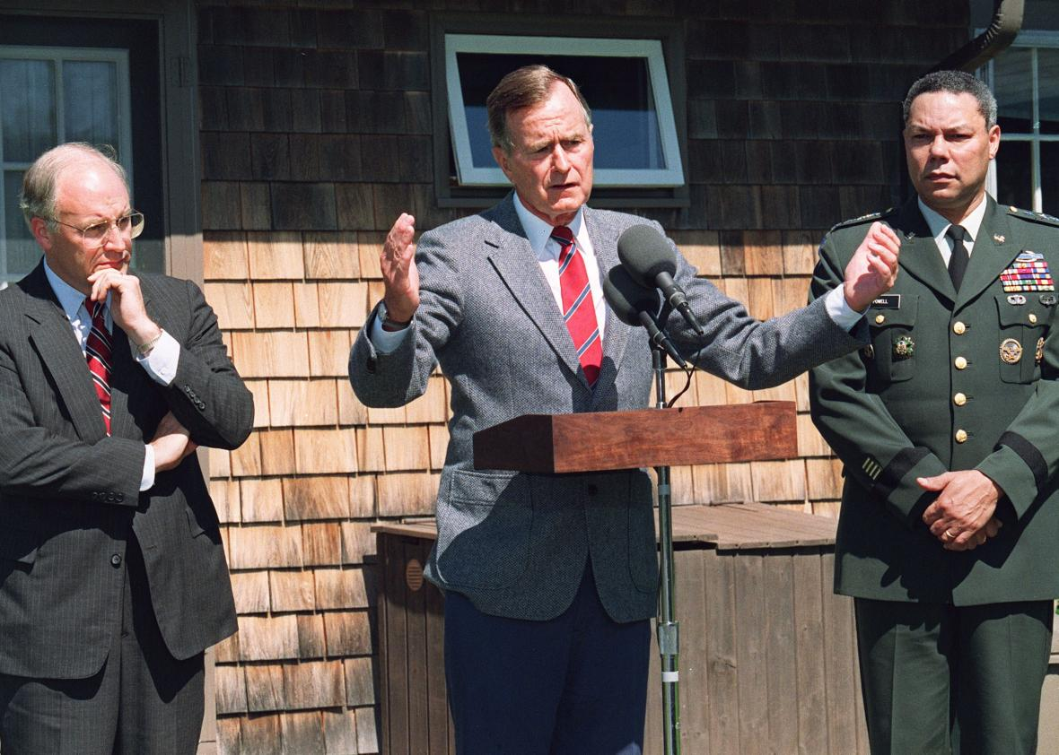 President George H.W. Bush addresses reporters on Aug. 22, 1990, flanked by Defense Secretary Dick Cheney and Chairman of the Joint Chiefs of Staff Gen. Colin Powell. (Jerome Delay/AFP/Getty Images)
