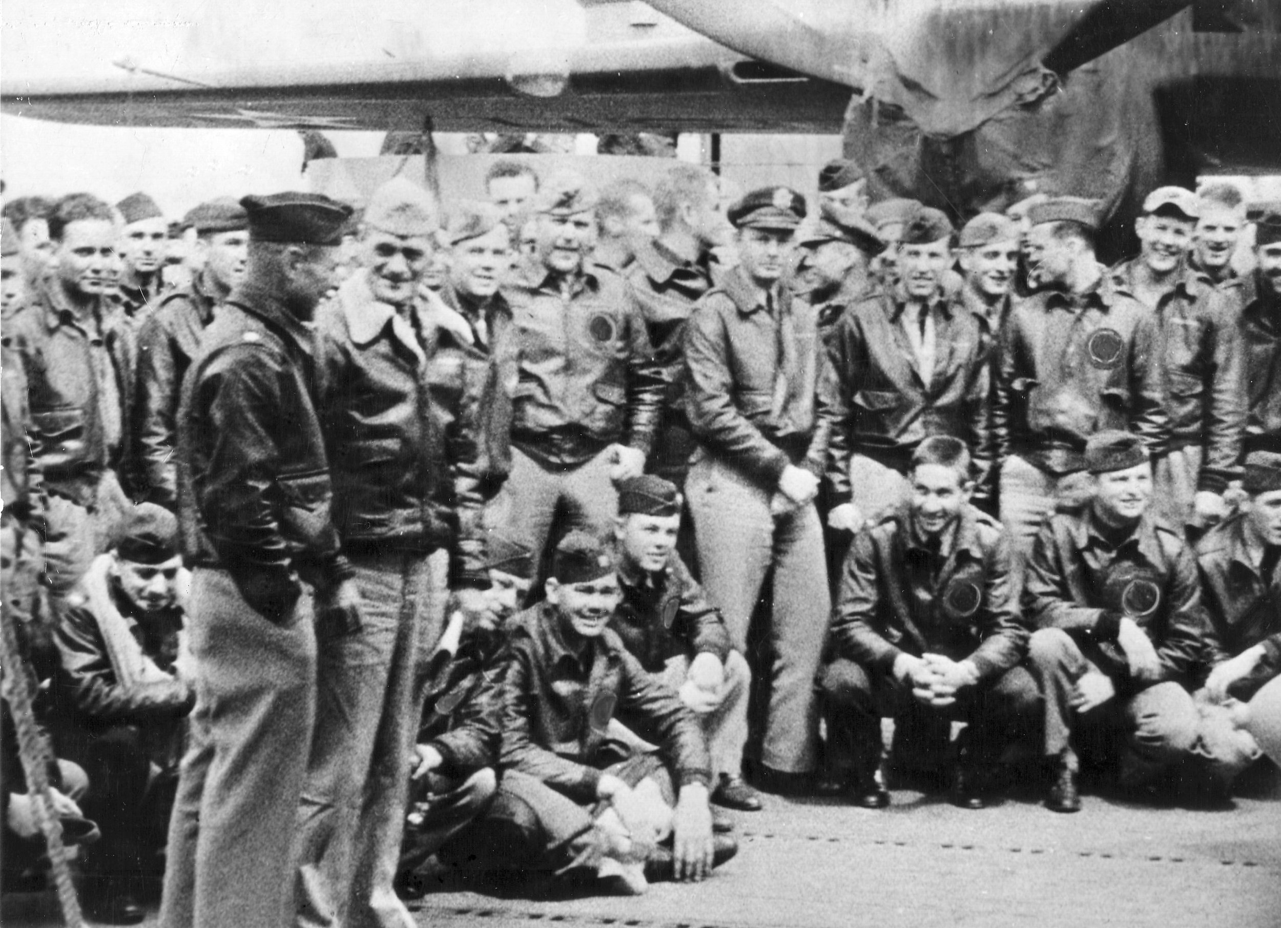 Orders in hand, Capt. Marc A. Mitscher, U.S.N., skipper of the U.S.S. Hornet (CU-8) chats with Maj. Gen. James Doolittle, U.S. Army. Some of the 80 Army fliers who took part in the historic Japanese raid are pictured with the two fliers. (Wikimedia)