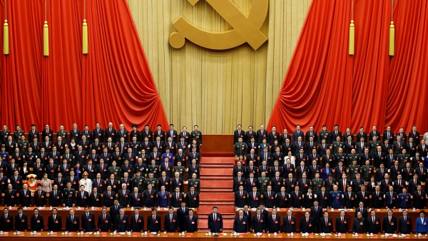 Xi Jinping stands before delegates at the closing session of the nineteenth National Congress of the Communist Party of China. (Thomas Peter/Reuters)