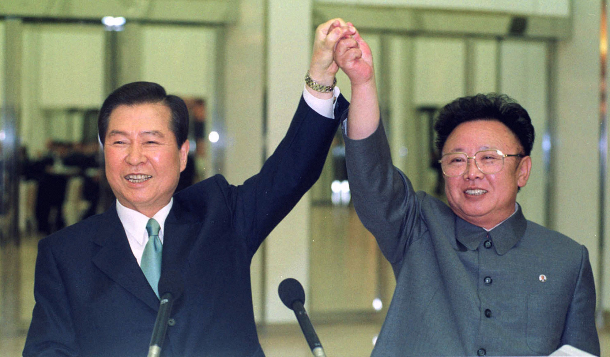 In this June 14, 2000, file photo, South Korean President Kim Dae-jung, left, and North Korean leader Kim Jong II raise their arms together before signing a joint declaration during a summit in Pyongyang, North Korea. The recent inter-Korean summit, the first in more than a decade, followed meetings between Kim Jong Un's father, Kim Jong II, with South Korean presidents in 2007 and 2000. ( Yonhap Pool Photo via AP )