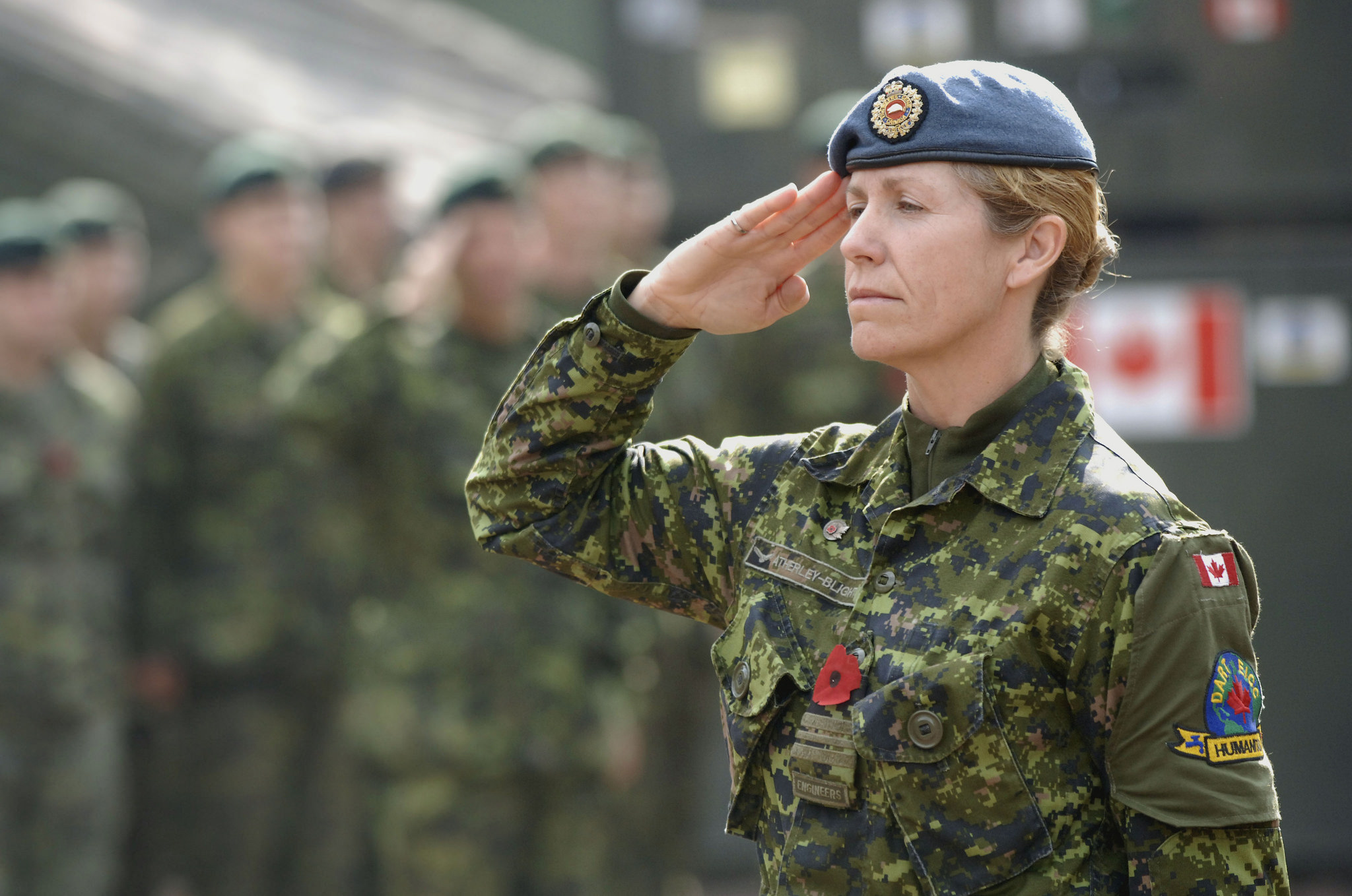Major Julia Atherley-Blight, Deputy Commanding Officer of the Canadian Forces Disaster Assistance Response Team, salutes during a Remembrance Day ceremony in Pakistan (Sgt Frank Hudec/Canadian Forces)
