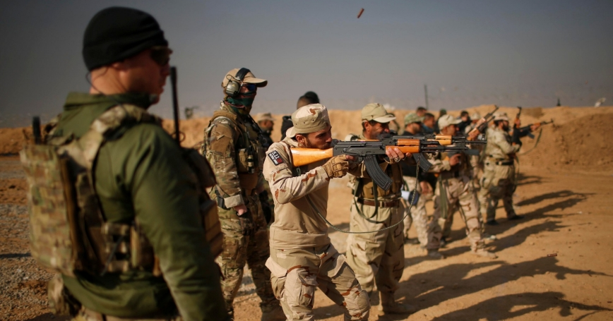 U.S. Army Special Forces members train Iraqi fighters from Hashid Shaabi at Makhmur camp in Iraq, December 11, 2016. (Mohammed Salem/Reuters)