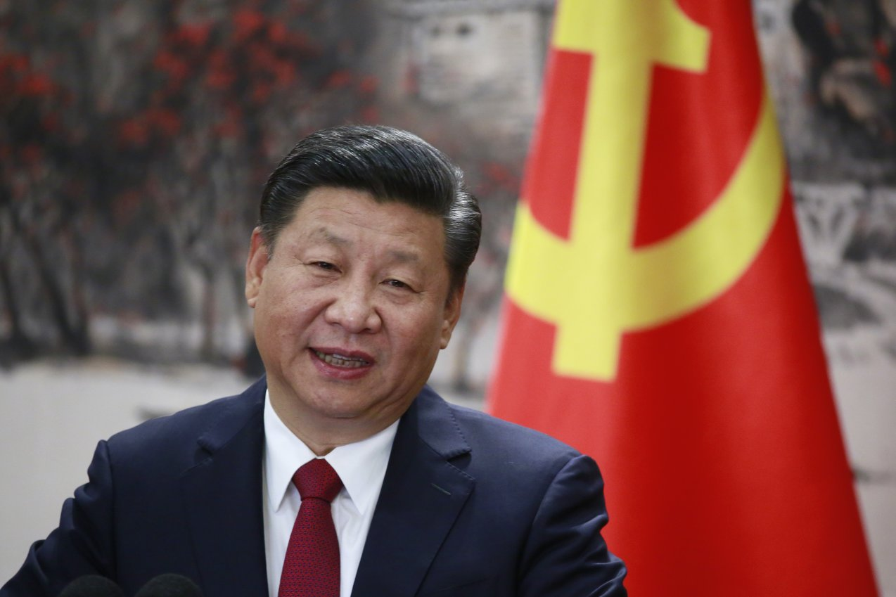 Xi Jinping speaks at a press conference at the Great Hall of the People in Beijing. (How Hwee Young/Wall Street Journal)