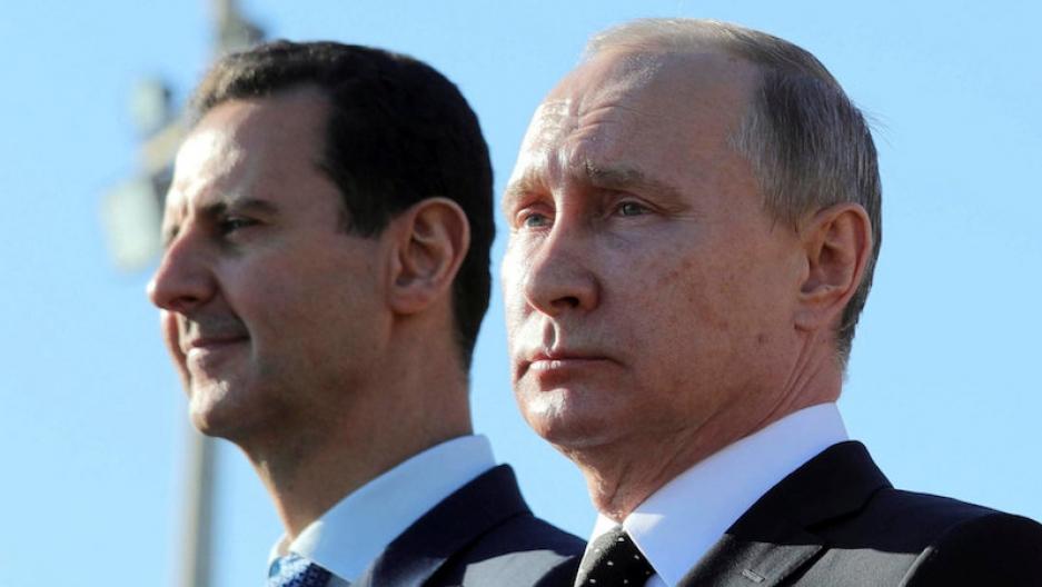 Russian President Vladimir Putin, right,and Syrian President Bashar al-Assad visit the Hmeymim air base in Latakia Province, Syria, Dec. 11, 2017. (Mikhail Klimentyev/Reuter)