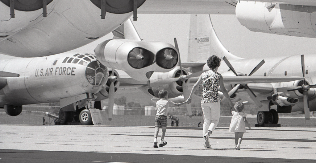 A family walking among SAC aircraft. (The Strategic Air Command and Aerospace Museum)