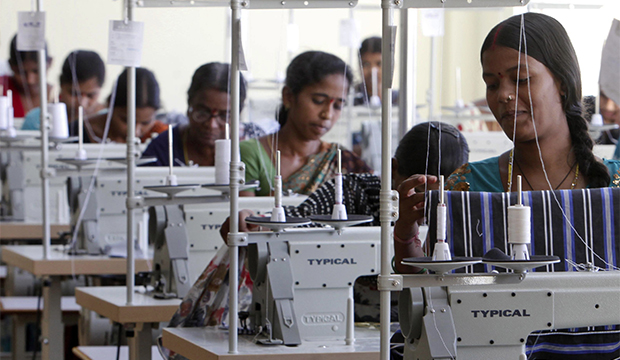 Indian workers sew at a garment factory on the outskirts of Hyderabad, India. (Mahesh Kumar/AP)